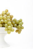 Grapes platter. Grapes on antique porcelain platter Royalty Free Stock Image