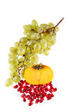 Grapes, pomegranate grains and persimmon Stock Photography