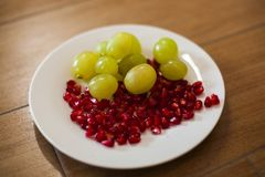 Grapes and pomegranate seeds stock photos