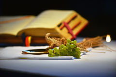 Grapes and prayer book. Grapes on a paten and prayer book in the background Royalty Free Stock Photography