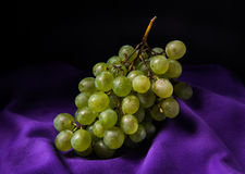 Grapes on purple table cloth Royalty Free Stock Photography