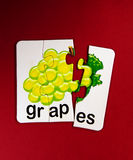 Grapes on puzzle Royalty Free Stock Photo