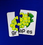 Grapes on puzzle Royalty Free Stock Image