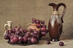 Grapes red and ceramic ware Stock Image