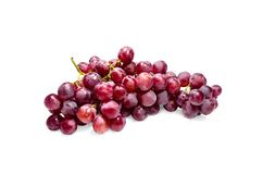 Grapes. Red grapes are a delicious bunch on a white background. clipping path Stock Image