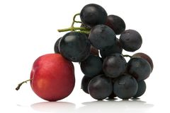 Grapes and red plum. Close-up of red plum and grapes over white background Stock Images