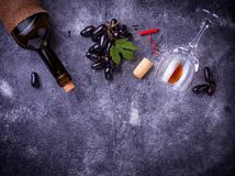 Grapes, red wine, glass, corkscrews and cork Royalty Free Stock Photography