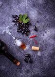 Grapes, red wine, glass, corkscrews and cork Royalty Free Stock Images