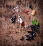 Grapes, red wine, glass, corkscrews and cork Royalty Free Stock Image