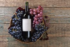 Grapes and red wine. Old paper label , copy space for your text. Top view Royalty Free Stock Images