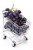 Grapes in shopping cart. Isolated Royalty Free Stock Photos