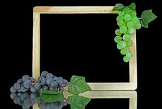 Grapes on a slate with copy space. Green and Purple Grapes on a slate with copy space Royalty Free Stock Image