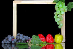 Grapes on a slate with copy space. Green and Purple Grapes on a slate with copy space Royalty Free Stock Images
