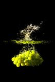 Grapes splash Royalty Free Stock Photography