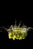 Grapes splash Stock Images