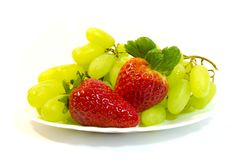 Grapes with strawberry Royalty Free Stock Images