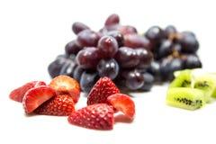Grapes, strawberrys and kiwis. Grapes, strawberrys and kiwi Fruits royalty free stock image