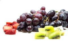 Grapes, strawberrys and kiwis. Grapes, strawberrys and kiwi Fruits royalty free stock images