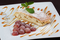 Grapes strudel with mint and caramel Stock Photography