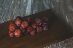 Grapes on table royalty free stock image