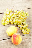 Grapes and two peaches Stock Image