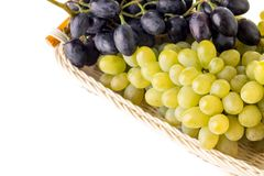 Grapes varieties in wicker basket isolated on whire background Royalty Free Stock Photos