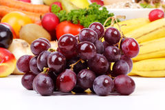 Grapes with vegetables and fruit Stock Image