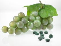 Grapes & vitamin tablets  Royalty Free Stock Photo