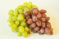 Grapes. On a white background, a bunch of white and pink kishmish, pitted Stock Photo