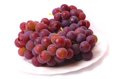 Grapes on the white plate. White background Stock Photography