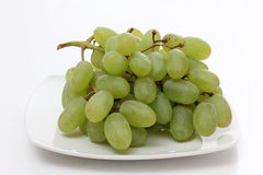 Grapes on white plate Royalty Free Stock Photo