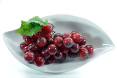 Grapes On White. The Grapes on Plate with white background Stock Photos