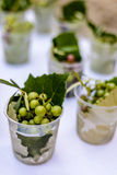 Grapes on a white table cloth. At a wedding reception's food station Stock Image