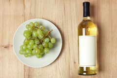Grapes and white wine Stock Images