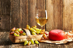 Grapes, white wine and cheese Royalty Free Stock Image