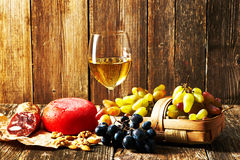 Grapes, white wine and cheese Royalty Free Stock Photo