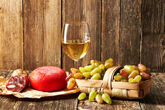 Grapes, white wine and cheese Royalty Free Stock Images