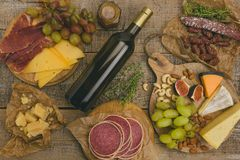 Grapes, white wine, cheese, honey and nuts over rustic weathered stock photography