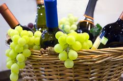 Grapes and wine. In basket Stock Image