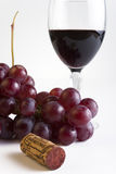 Grapes and wine. Glass of red wine with cluster of grapes and cork Stock Photo