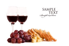 Grapes and Wine. With cheese and bread Royalty Free Stock Images