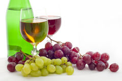 Grapes and wine. Glasses of white and red wine and grapes on white background Royalty Free Stock Photo