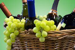 Grapes and wine. Wine and grapes in a basket Stock Image