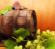 Grapes and a wine barrel Royalty Free Stock Photography