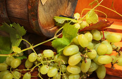 Grapes and a wine barrel. Over wooden background stock photos