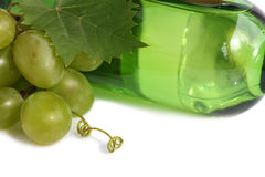 Grapes and a wine bottle Royalty Free Stock Photography