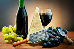 Grapes, wine and cheese Stock Photos