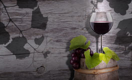 Grapes and wine glass on a wooden vintage barrel Royalty Free Stock Photo