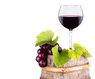 Grapes and wine glass on a wooden vintage barrel Stock Images