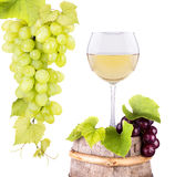 Grapes and wine glass on a wooden vintage barrel Royalty Free Stock Photos